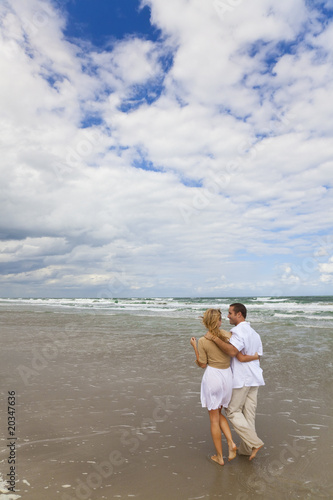 Man and Woman Couple Having Romantic Walk On A Beach