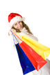 Attractive smiling Santa Claus woman doing Christmas shopping