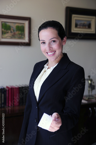 female lawyer at office giving business card