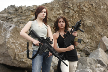 Sexy women with assault guns