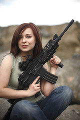 Sexy woman with assault gun