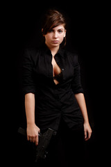 sexy woman with an automatic pistol dressed in black
