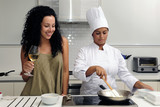 Cookery course: woman learning how to cook risotto