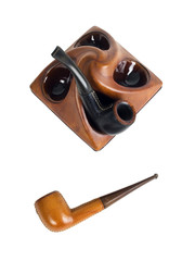 leather pipes in pipe stand