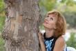 Beautiful woman near tree