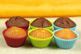 Cupcakes in colorful molds poster