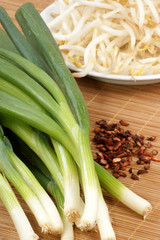 spring onions, bean sprouts on a timber board