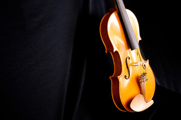 violin body leaning on black