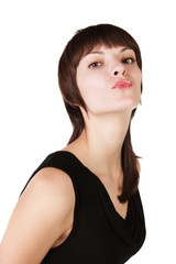 The young girl shows a mimicry a kiss on white background