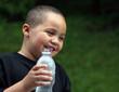 Latino boy with bottle