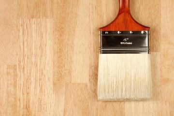 Paint Brush on Wood Surface