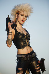 A sexy punk rocker woman with two automatic pistols.