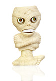 Beige plastic toy as a mummy poster