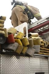 Fireman unloading truck