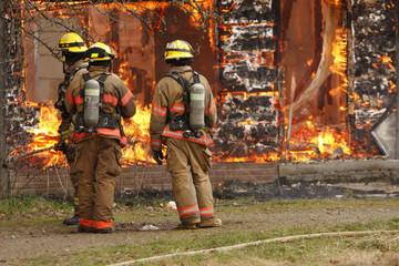 Firemen at burning house