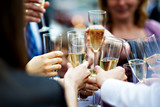 Glasses of champagne in hands of guests at wedding poster