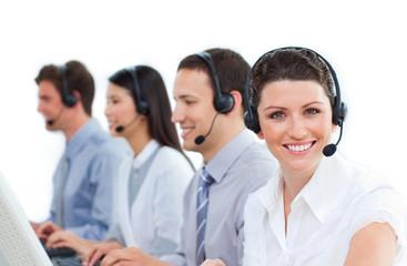 Multi-ethnic business team talking on headset