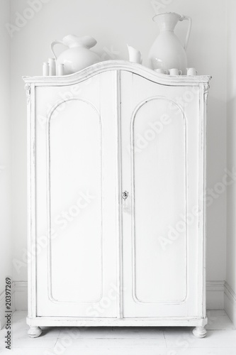 Closed storage cupboard painted white