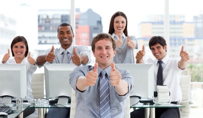 Lively business people with thumbs up