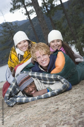 Group of friends lie in sleeping bags
