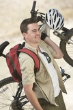 Man carrying mountain bike