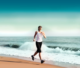 young woman jogging on the beach
