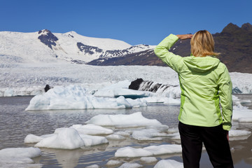Environmental Concept Woman Hiker Looking At Melting Glacier