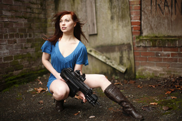 Sexy young woman with assault rifle