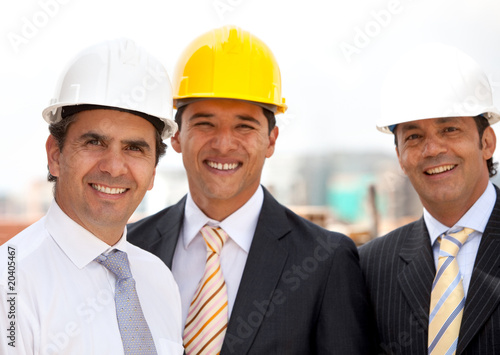 Male engineers smiling