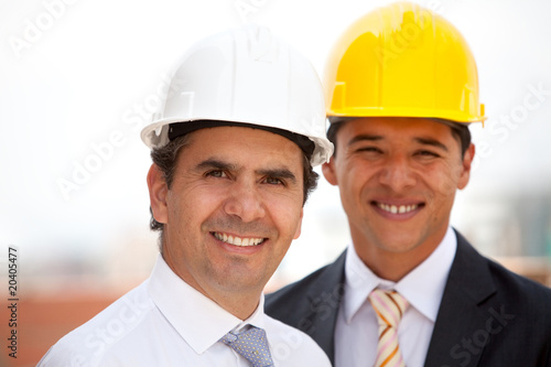 Male architects smiling
