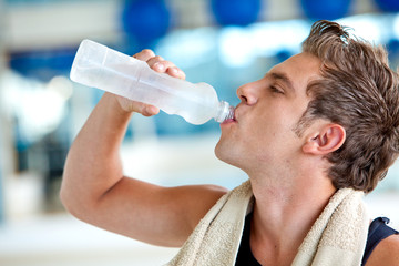 Gym man drinking water