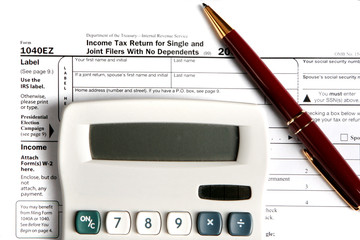 Tax form EZ with calculator and pen