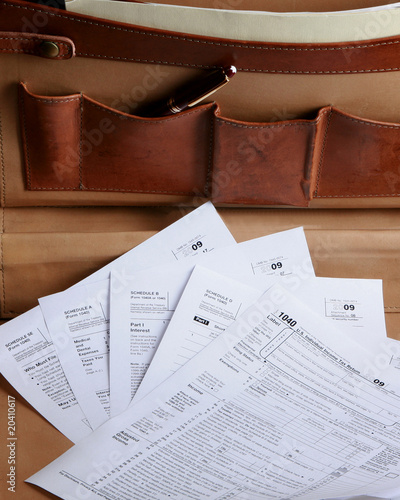 Tax forms in a leather briefcase - vertical