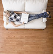 Overhead View of Woman With Book on Couch