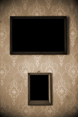 two photo-frames on wall