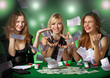 Poker players in casino with cards and chipsv