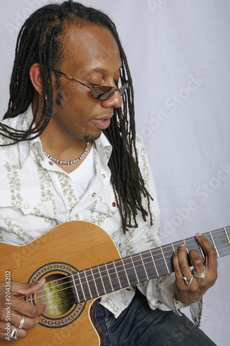 Close-up of a man playing the guitar