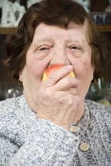 Close up senior eat an apple