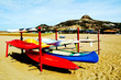 colourful kayaks on sandy sunny beach in Sardegna, italy