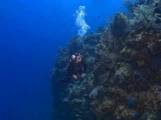 Female Diver off the wall in Cayman Brac