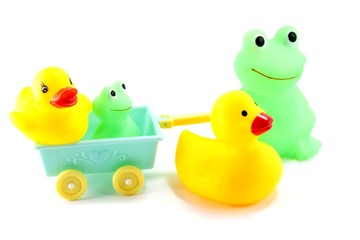 Mother and baby toy frogs and ducks