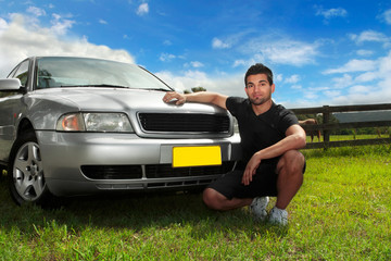 Man beside car in afternoon sun