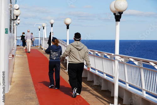 Couple walking on cruise liner