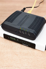 dsl modem with router and cables with selective focus