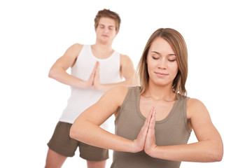 Fitness - Young healthy couple in yoga position