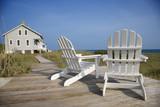 Fototapety Chairs on Deck Facing Ocean