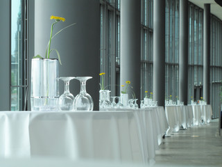 Glassware and vases on banquet tables