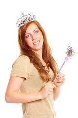 Attractive young woman holding a magic wand