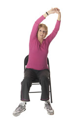 old woman stretch exercise on chair