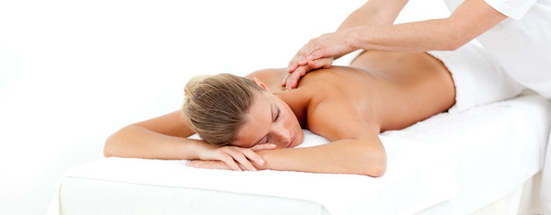 Attractive woman being massaged